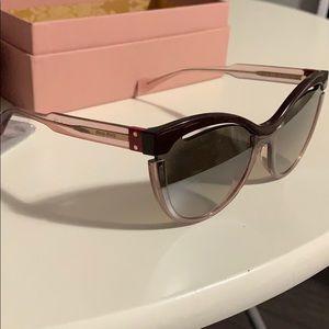 Authentic Miu Miu sunglasses.